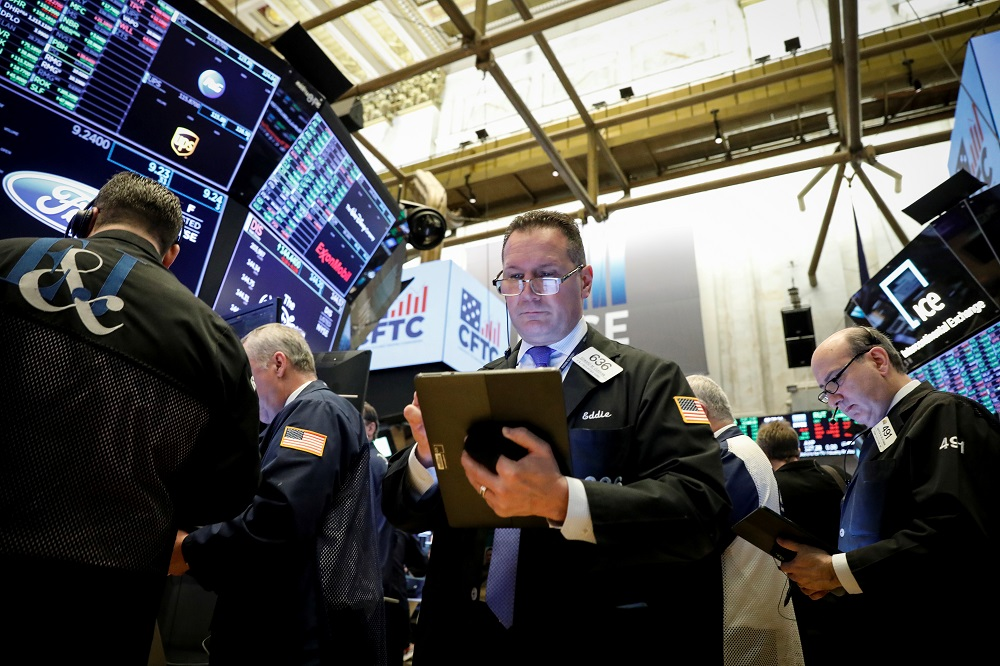 Traders work on the floor at the New York Stock Exchange. — Reuters pic