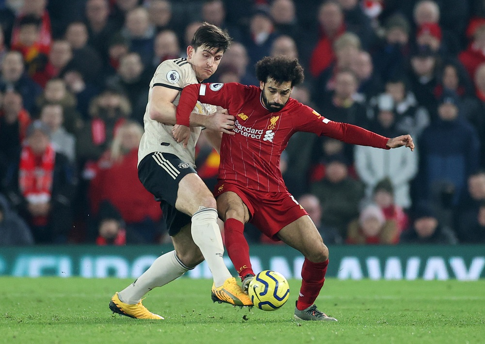 Manchester United's Harry Maguire in action with Liverpool's Mohamed Salah at Anfield in Liverpool