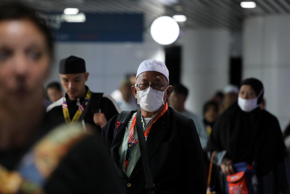 A passenger wears a mask at Kuala Lumpur International Airport in Sepang January 21, 2020. — Reuters pic