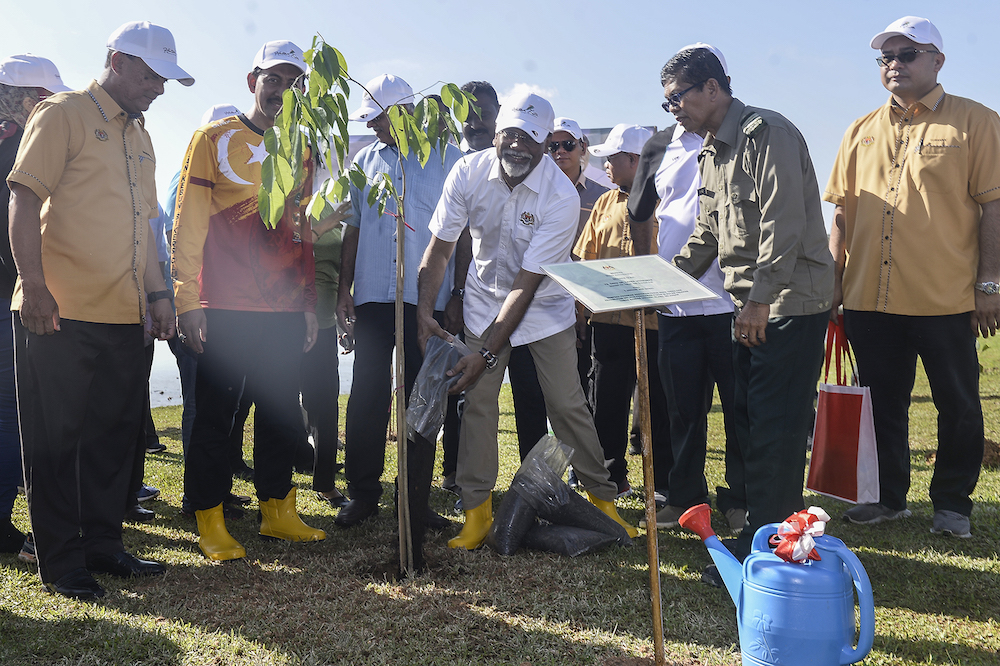 Datuk Dr Xavier Jayakumar plants a tree after launching the Restoration, Reclamation and Rehabilitation Through Tree Planting Programme in Klang January 5, 2020. — Picture by Miera Zulyana