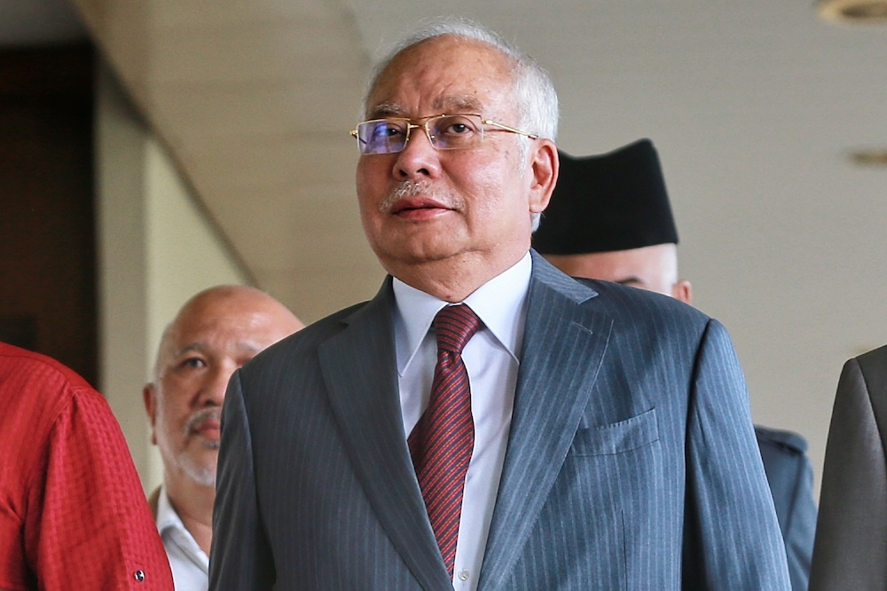 Datuk Seri Najib Razak claims the current government is already planning to compensate an unnamed company for the HSR project cancellation. — Picture by Ahmad Zamzahuri
