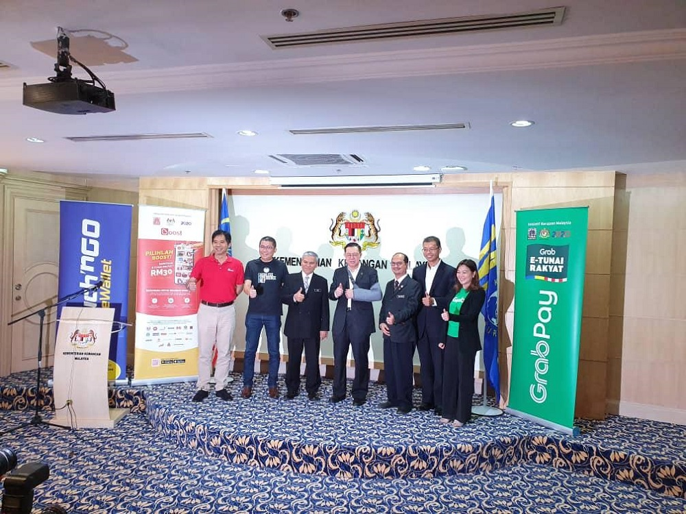 Finance Minister Lim Guan Eng and Khazanah deputy managing director Tengku Datuk Seri Azmil Zahruddin Raja Abdul Aziz (2nd right) take a group photo during the launch of e-Tunai Rakyat in Putrajaya January 14, 2020. — Picture courtesy of Touch 'n Go eWallet