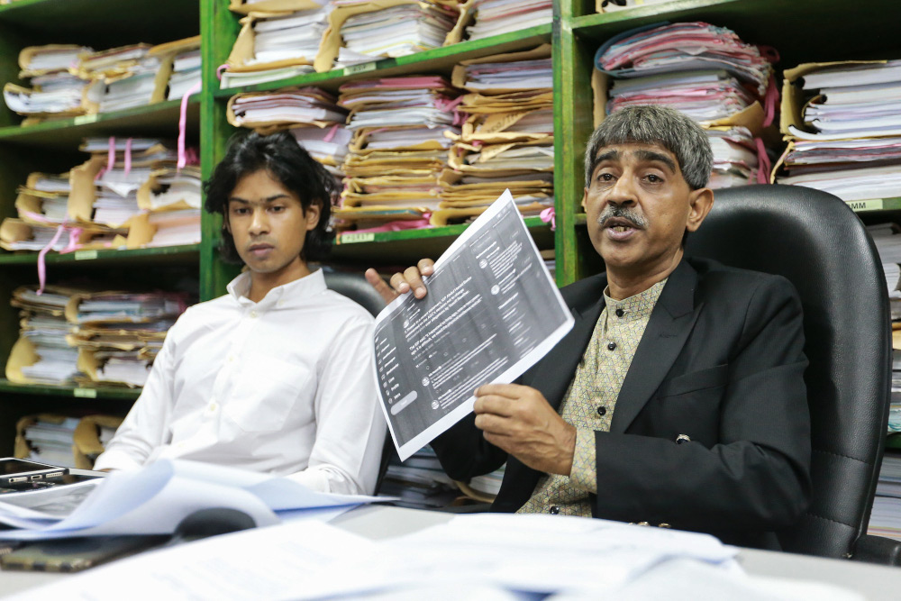 Muhammad Yusoff Rawther's lawyer Haniff Khatri (right) speaks to reporters during a press conference in Petaling Jaya January 17,2 020. — Picture by Ahmad Zamzahuri