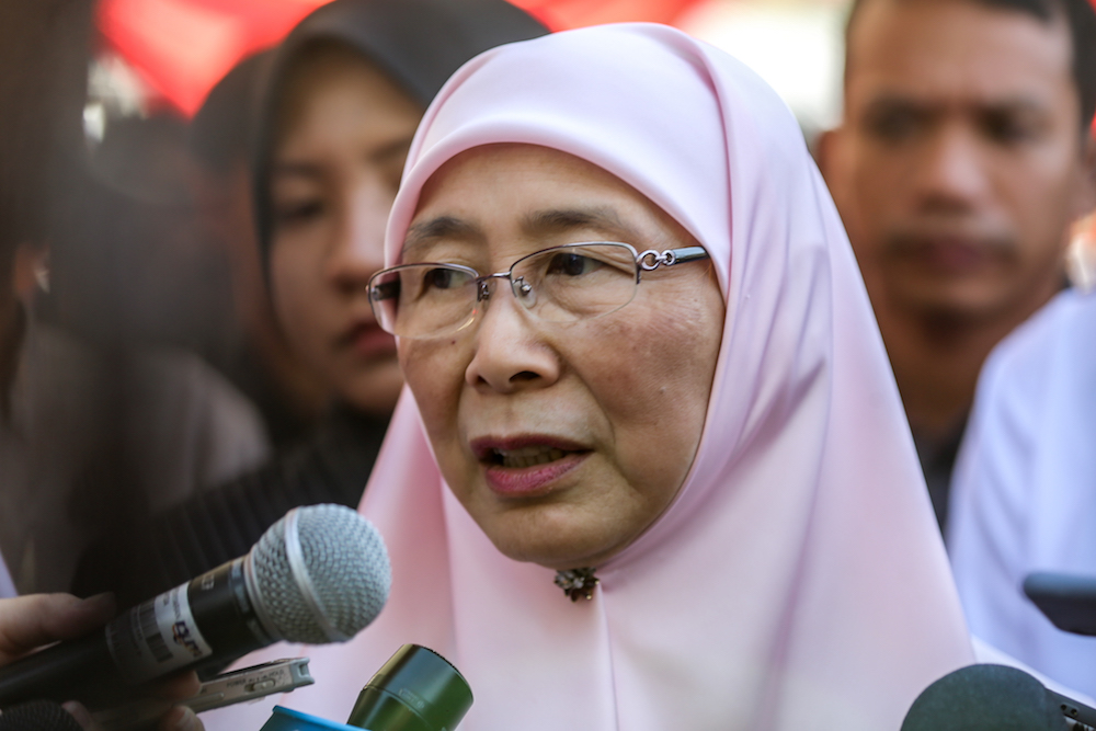 Formey deputy prime minister Datuk Seri Dr Wan Azizah Wan Ismail said the money from the Qatar Fund for Development was broken down into three sectors: health, education, and livelihood. — Picture by Firdaus Latif