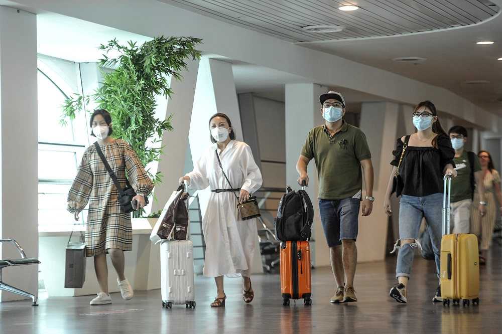 File picture shows tourists wearing protective masks at the arrival hall in KLIA 2, Sepang January 27, 2020. — Picture by Shafwan Zaidon