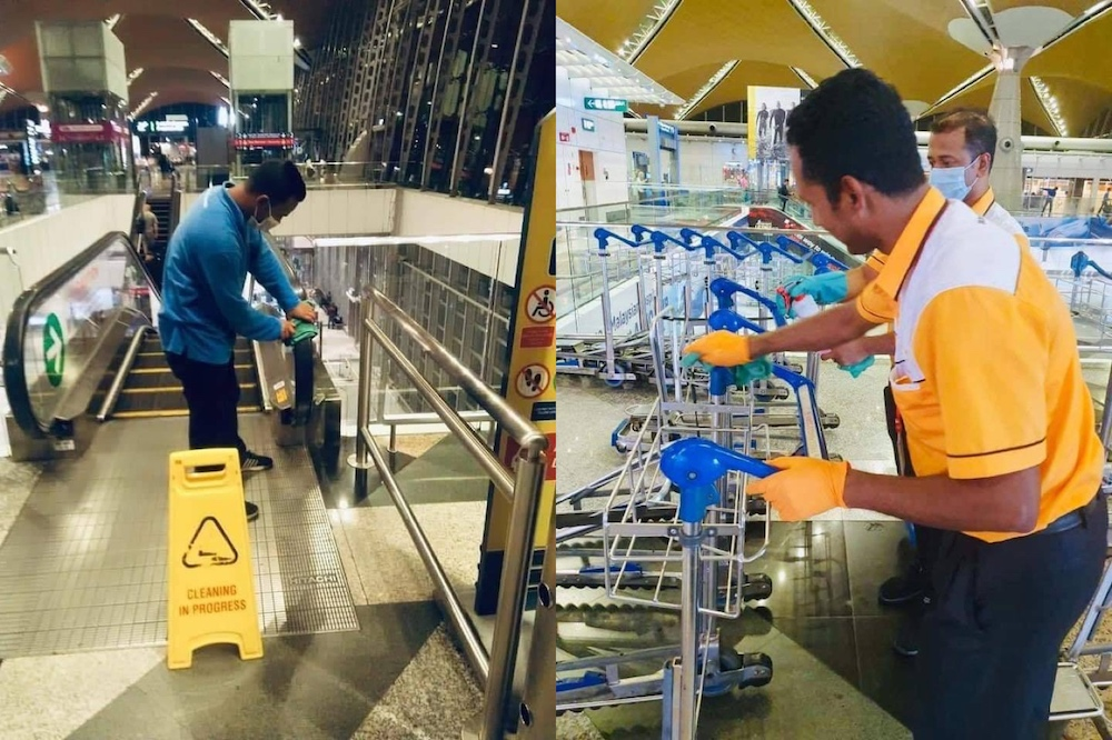 The workers donned protective gear while wiping down surfaces that came into frequent contact with hands at the airport. — Pictures from Facebook/penangkini