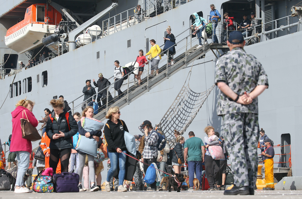 Evacuees from Mallacoota arrive on the navy ship HMAS Choules at the port of Hastings, Victoria, Australia, January 4, 2020. — Reuters pic
