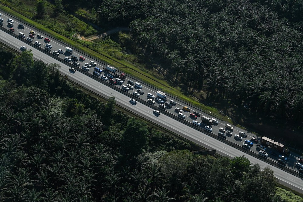 An aerial view of slow-moving northbound traffic near the Slim River Toll Plaza on January 23, 2020. — Bernama pic