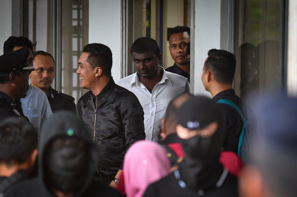 Gadek assemblyman G. Saminathan (white shirt) is seen at the Ayer Keroh Sessions Court in Melaka December 18, 2019. — Bernama pic