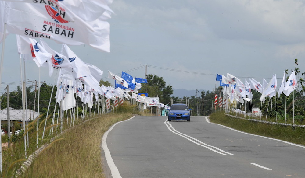 Party flags line the Membakut-Bengawan road January 5, 2020 ahead of the Kimanis by-election on January 18. — Bernama pic
