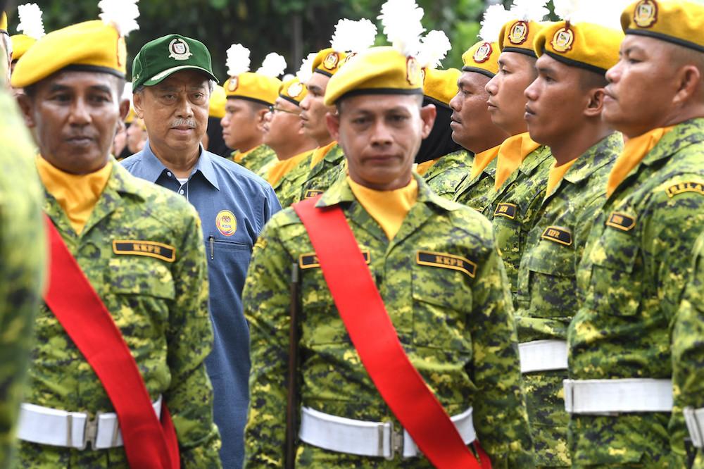 Tan Sri Muhyiddin Yassin inspects a guard of honour by Rela members in Papar January 11, 2020. — Bernama pic