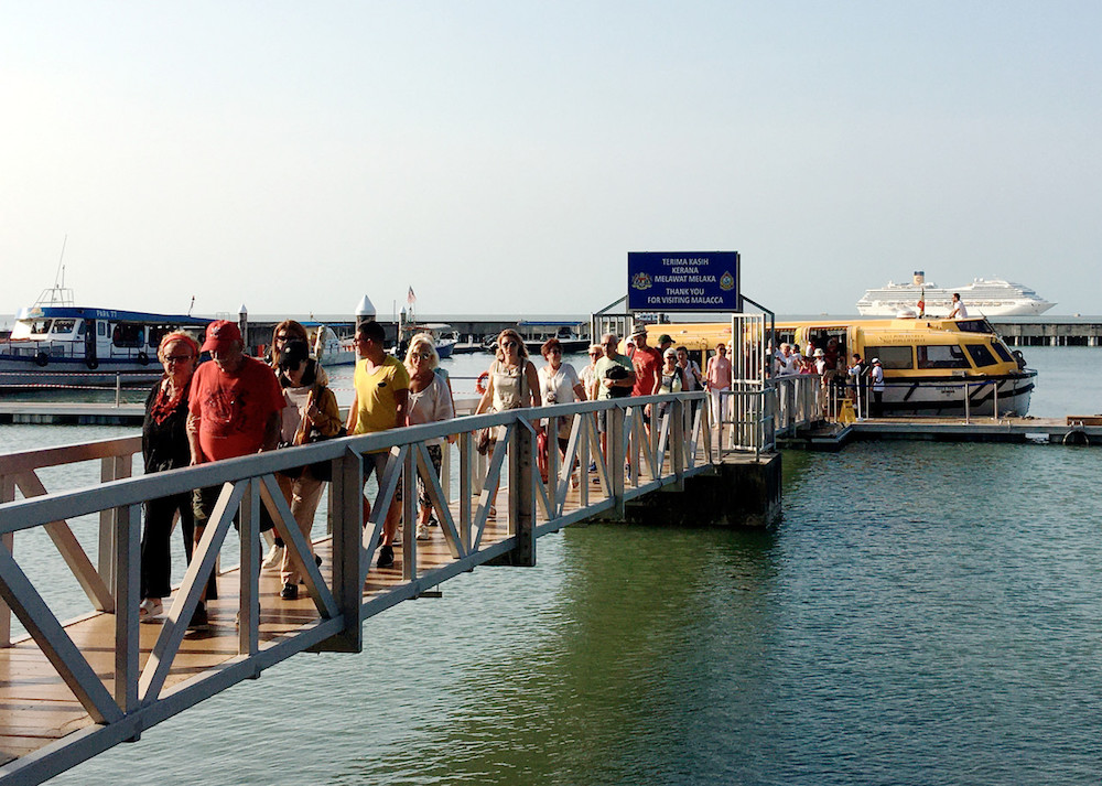 Tourists disembark a boat at Melaka Marina jetty November 13, 2019. — Bernama pic