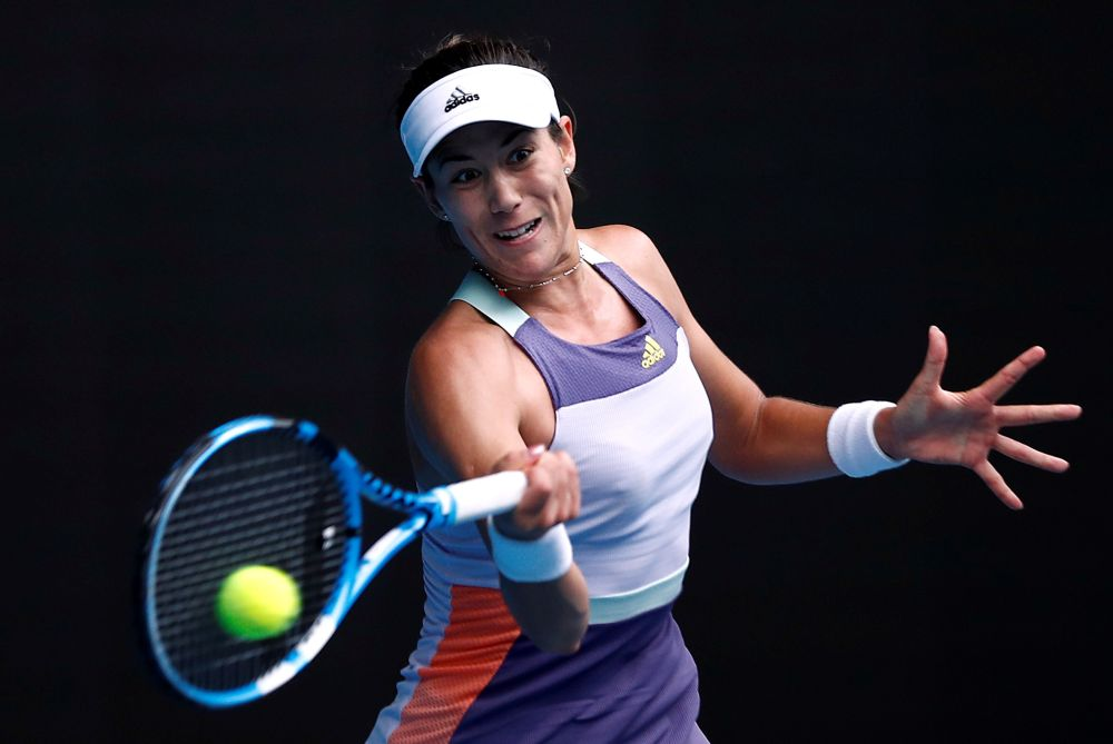 Muguruza looked in big trouble as she trailed 3-0 in the final set to Slovenia's Tamara Zidansek but she survived to fight another day. — Reuters pic