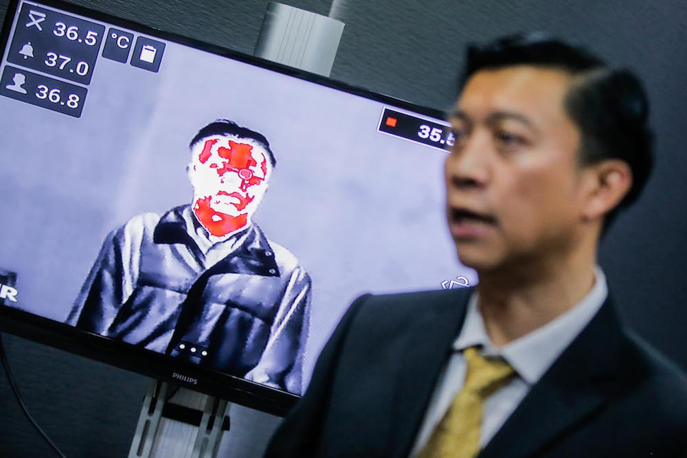 Inframatrix managing director Richard Lee explains how a thermal imaging camera works at his office in Cheras January 31, 2020. — Picture by Hari Anggara