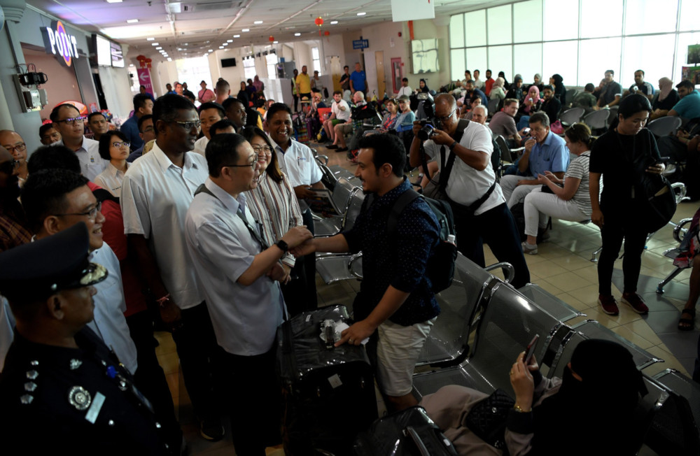 Finance Minister Lim Guan Eng speaks to tourists during his visit to the Swettenham Pier Cruise Terminal in George Town, Penang, January 11, 2020. — Bernama pic