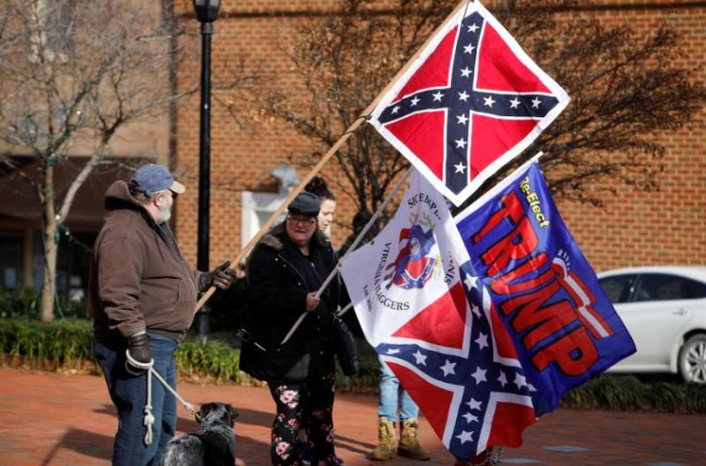 File picture shows supporters of Confederate statues and symbols displaying Confederate flags along with one supporting US President Donald Trump as they gather on a street corner during the Lee-Jackson Day state holiday in Lexington, Virginia, January 17, 2020. — Reuters pic
