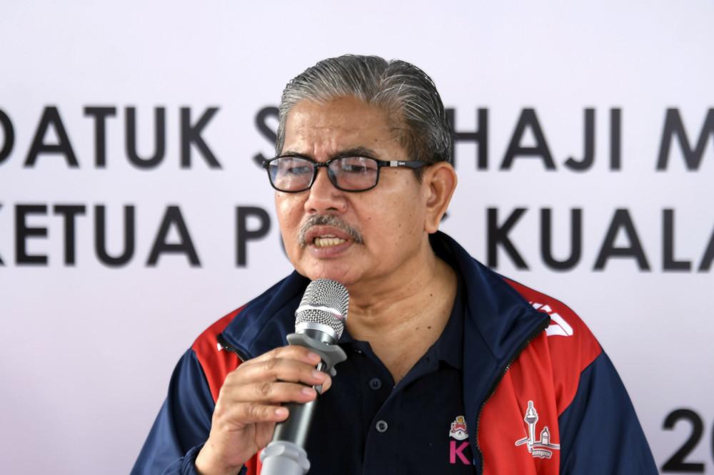 Kuala Lumpur police chief Datuk Seri Mazlan Lazim gives a speech at Perumahan Awam Seri Perak, Sentul, January 11, 2020. — Bernama pic