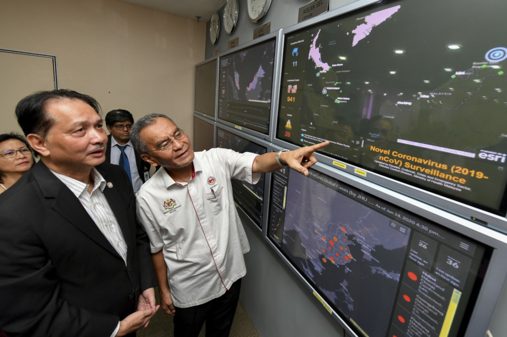 Health Minister Datuk Seri Dzulkefly Ahmad monitors the status of the virus' spread in Malaysia and around the world after a press conference on the novel coronavirus in Putrajaya January 25, 2020. With him is Health D-G Datuk Dr Noor Hisham Abdullah. — Bernama pic