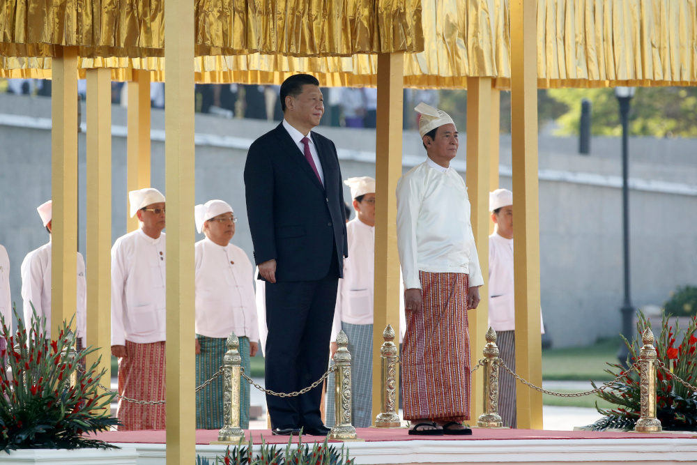 Chinese President Xi Jinping and Myanmar President Win Myint stand during a national anthem at the welcome ceremony in the Presidential Palace in Naypyitaw, Myanmar January 17, 2020. — Reuters pic