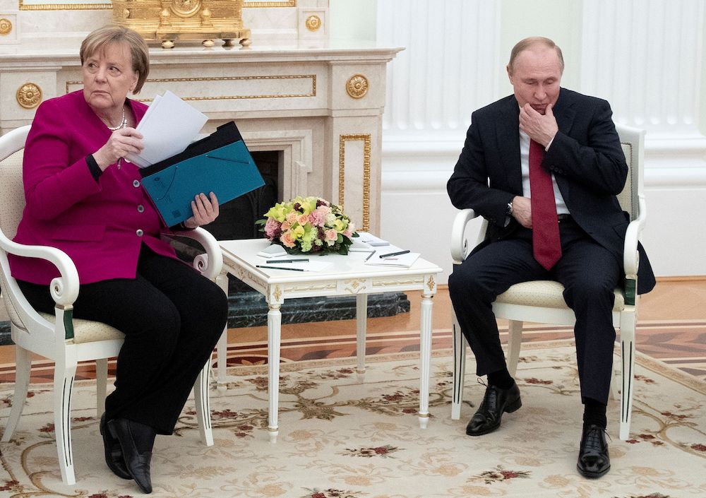 German Chancellor Angela Merkel holds papers during the talks with Russian President Vladimir Putin in the Kremlin in Moscow, Russia, January 11, 2020. ― Reuters pic