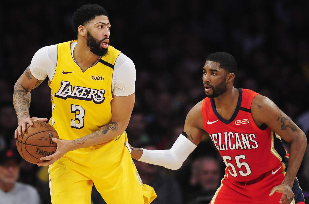 Los Angeles Lakers forward Anthony Davis (3) moves the ball against New Orleans Pelicans guard E'Twaun Moore (55) during the first half at Staples Center. Gary A. Vasquez-USA TODAY Sports pic via Reuters