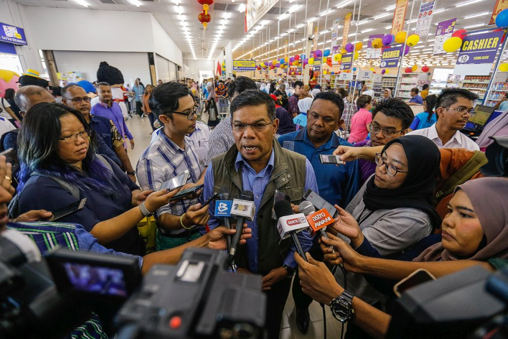 Domestic Trade and Consumer Affairs Minister Datuk Seri Saifuddin Nasution Ismail speaks to reporters at the official opening ceremony of TF Value-Mart in Balik Pulau January 9, 2020. — Picture by Sayuti Zainudin