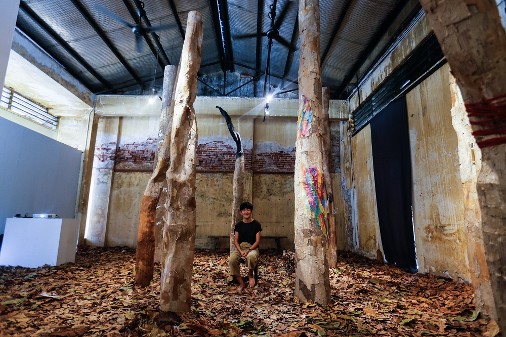 Tan Lay Heong poses with her art installation 'A Real Fake Forest' at the Hin Bus Depot in George Town, Penang January 22, 2020. — Picture by Sayuti Zainudin