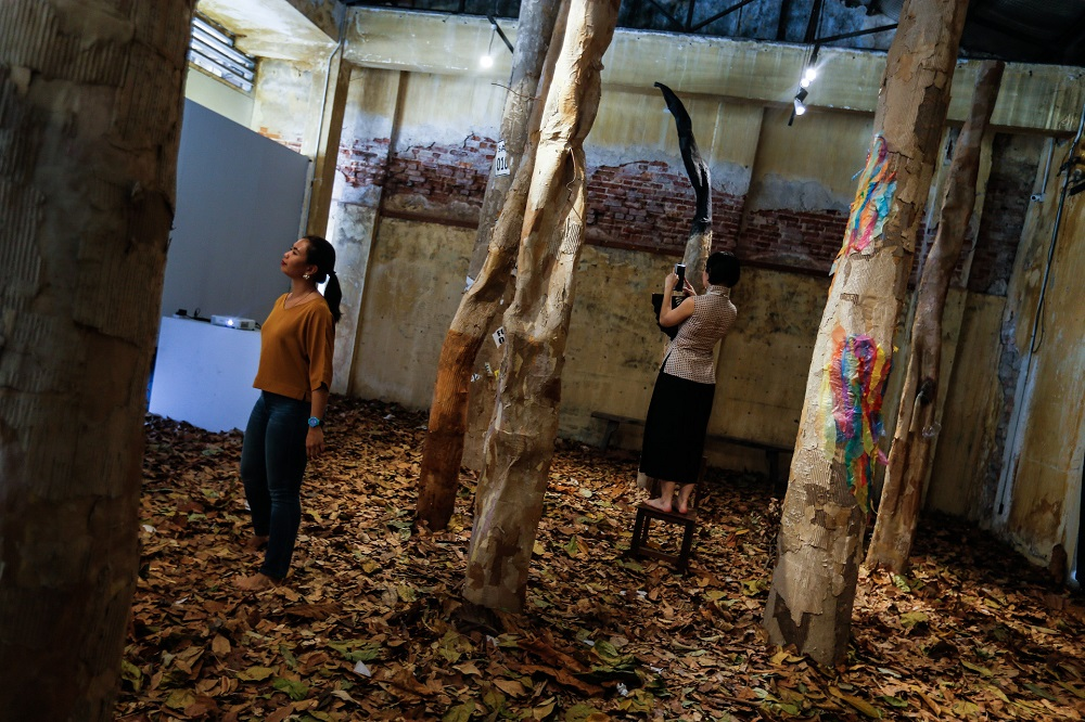 Visitors look at the art installation 'A Real Fake Forest' at the Hin Bus Depot in George Town, Penang January 22, 2020. — Picture by Sayuti Zainudin