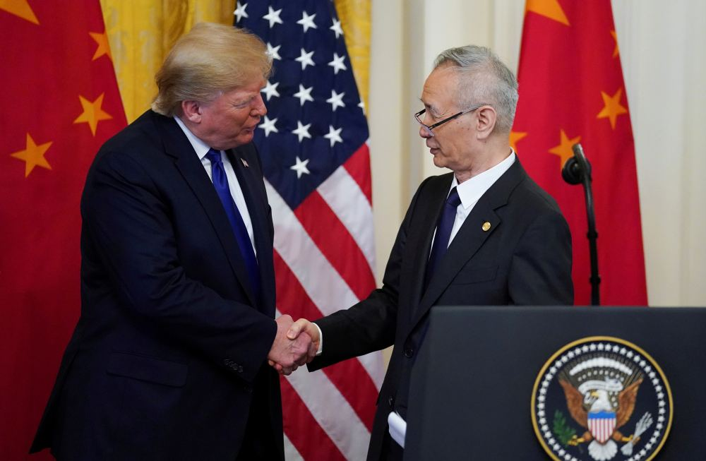 US President Donald Trump shakes hands with Chinese Vice Premier Liu He during a signing ceremony for 'phase one' of the US-China trade agreement in Washington January 15, 2020. ― Reuters pic