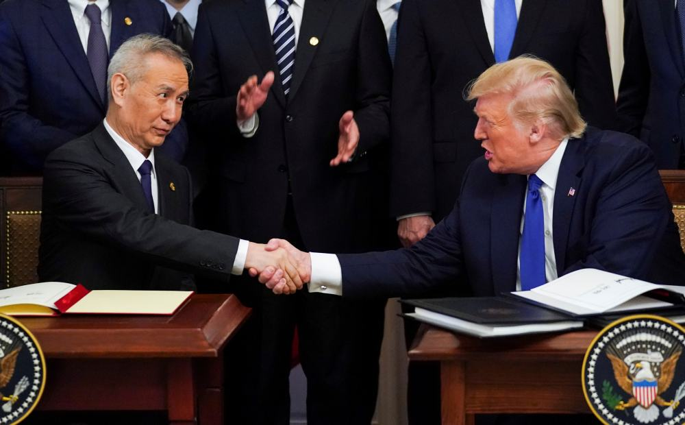 Chinese Vice Premier Liu He and US President Donald Trump shake hands after signing 'phase one' of the US-China trade agreement in Washington January 15, 2020. ― Reuters pic