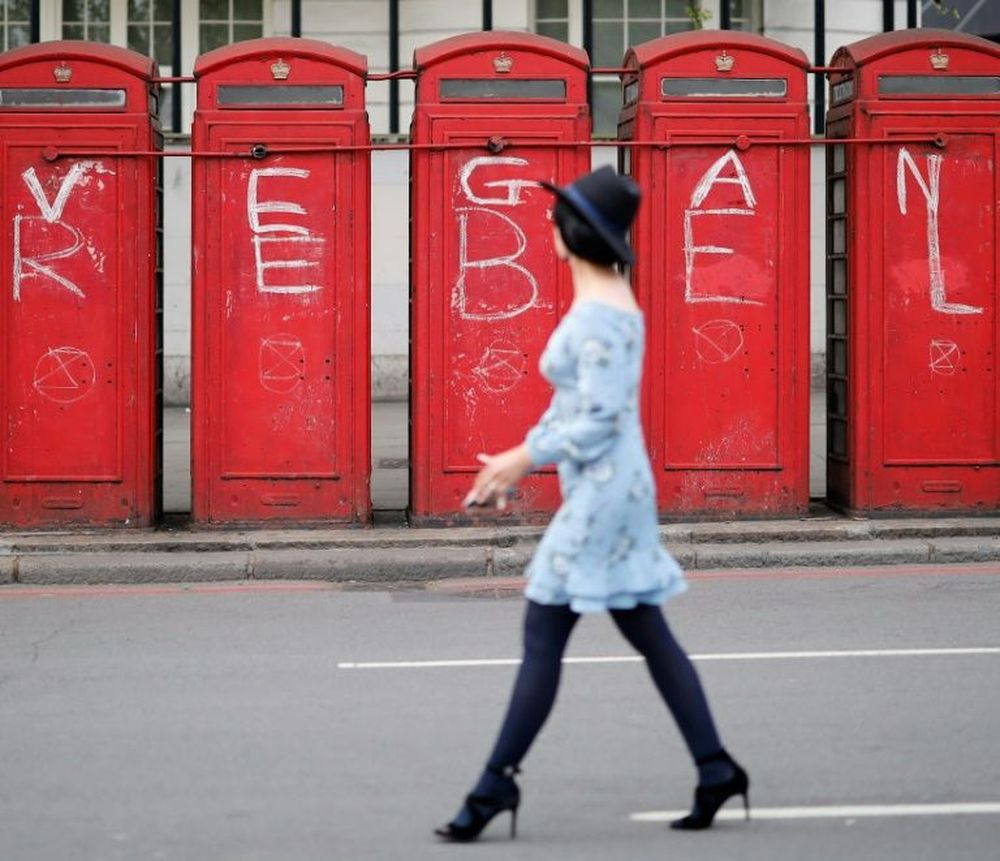 Vegan protest: London phone boxes have been daubed by climate activists. — AFP pic