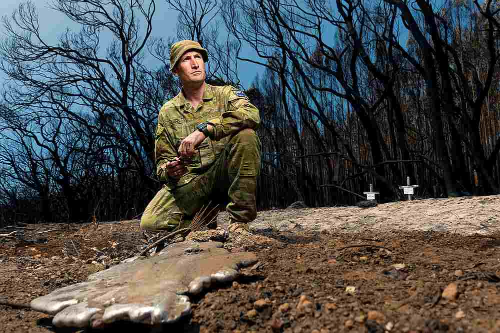 Lieutenant Kynan Lang visits the scene where his uncle and cousin died in a bushfire to place a memorial on Kangaroo Island, Australia, January 14, 2020. — Australian Department of Defence handout via Reuters