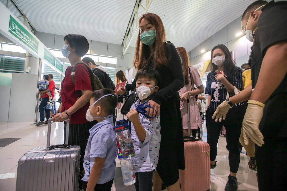 Visitors in face masks land at Sultan Azlan Shah Airport in Ipoh January 30, 2010. — Picture by Farhan Najib