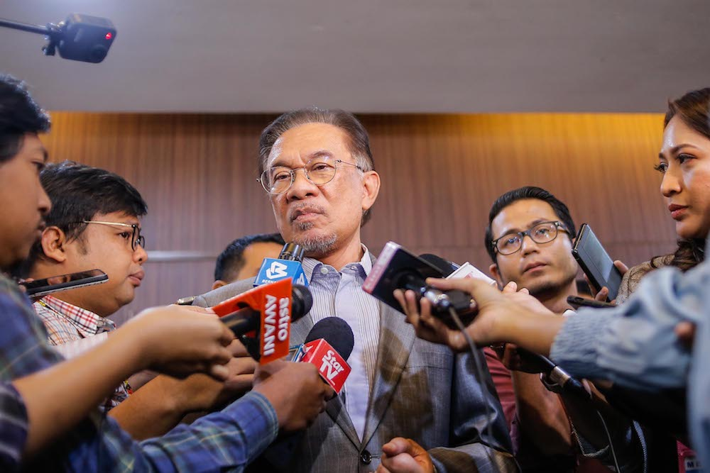 Datuk Seri Anwar Ibrahim said the Malaysian government needs to continue strengthening the capacity of the country's healthcare system to cope with the Covid-19 infection. — Picture by Hari Anggara
