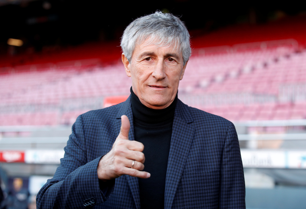 New FC Barcelona coach Quique Setien poses for a photograph after the press conference at Camp Nou, Barcelona January 14, 2020. — Reuters pic