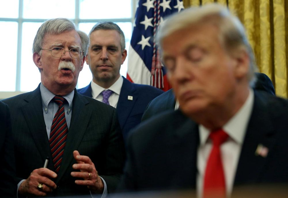 """File picture shows US President Donald Trump listening as his national security adviser John Bolton speaks during a presidential memorandum signing for the """"Women's Global Development and Prosperity"""" initiative in the Oval Office, February 7, 2019. — Reuters pic"""