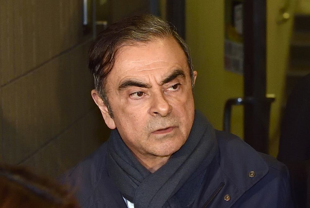 Former Nissan chairman Carlos Ghosn leaving the office of his lawyer Junichiro Hironaka in Tokyo April 3, 2019. — AFP pic
