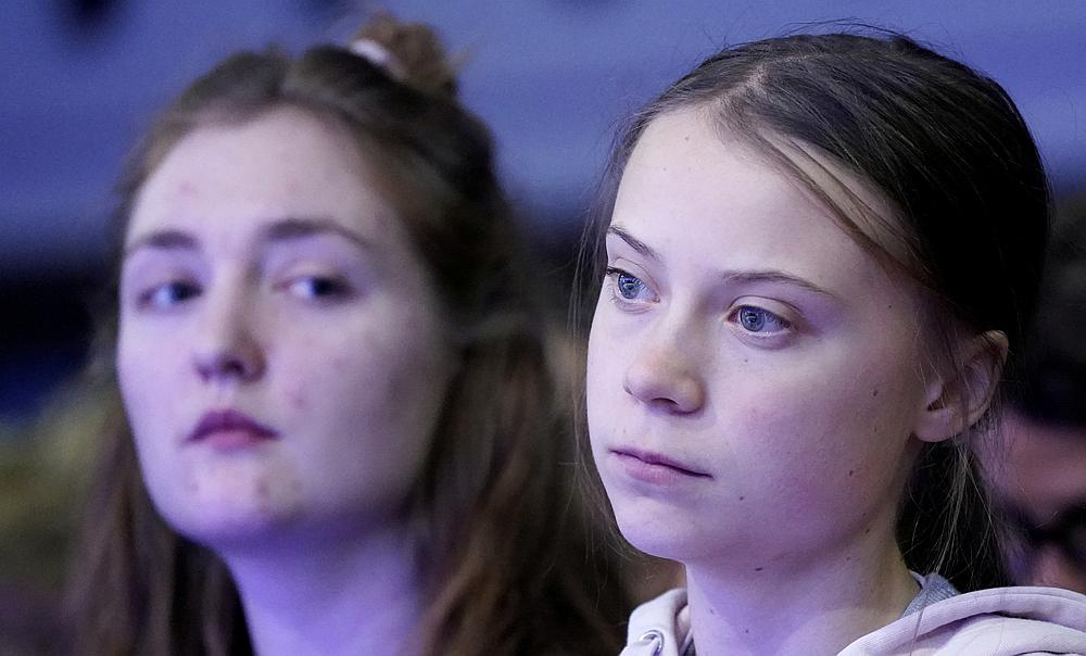 Swedish climate change activist Greta Thunberg (right) and Swiss activist Loukina Tille at the World Economic Forum in Davos, Switzerland January 21, 2020. — Reuters pic