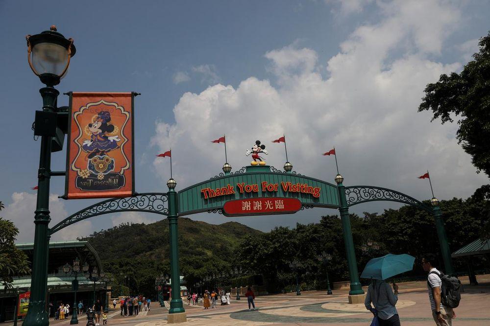 Visitors walk past the entrance to Hong Kong Disneyland in Hong Kong, China, October 10, 2019. — Reuters pic