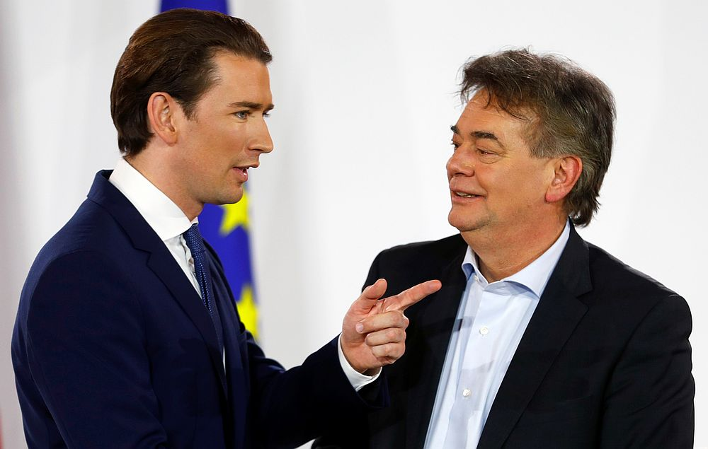 Head of Austria's Green Party Werner Kogler (right) and head of People's Party (OeVP) Sebastian Kurz talk after delivering a statement in Vienna, Austria January 2, 2020. — Reuters pic