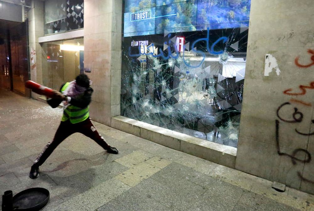 The commercial district of Hamra, a banking hub, was the scene of overnight scuffles between security forces and protesters furious over the curbs that have trapped their savings. — AFP pic