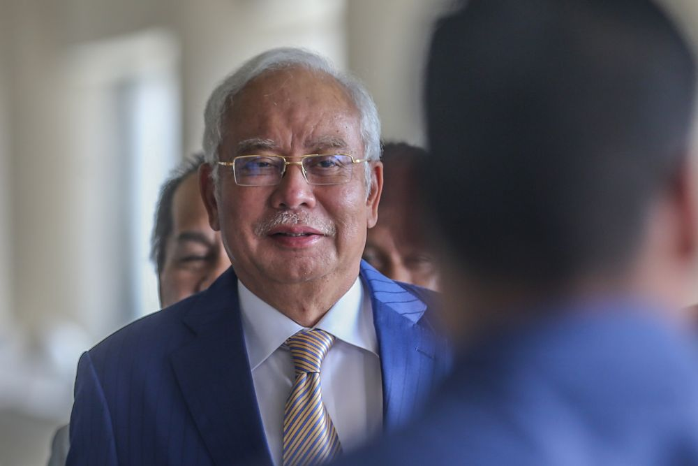 The former prime minister did so while summarising Senior Defence Minister Datuk Seri Ismail Sabri Yaakob's announcement that the MCO would be lifted on March 4, with states still under the order to be downgraded to the CMCO. — Picture by Firdaus Latif