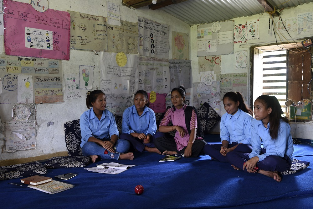 In this photograph taken on September 12, 2019 Asha Charti Karki (centre), who got married at age 16, mentors young girls on the importance of education in Barahataal in Surkhet District, some 520km west of Kathmandu. ― AFP pic