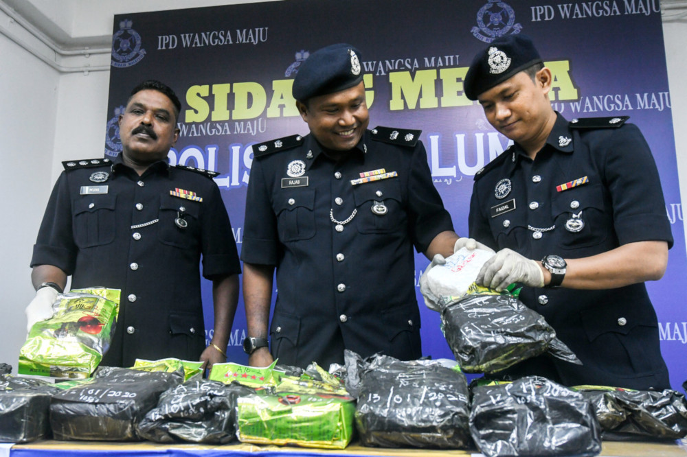 Wangsa Maju district police chief Supt Rajab Ahad Ismail (centre) with the seized drugs at the Wangsa Maju district police headquarters January 20, 2020. — Bernama pic