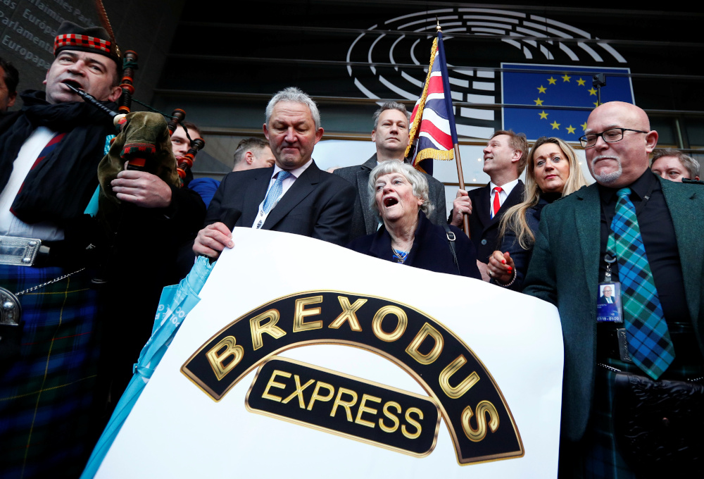 British pro-brexit Members of the European Parliament leave the EU Parliament for the last time in Brussels January 31, 2020. — Reuters pic