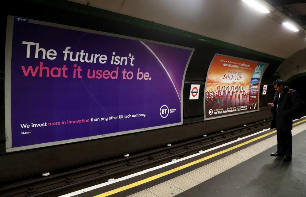 British Telecom (BT) advertisement is displayed at Goodge Street underground station in London November 15, 2019. — Reuters pic