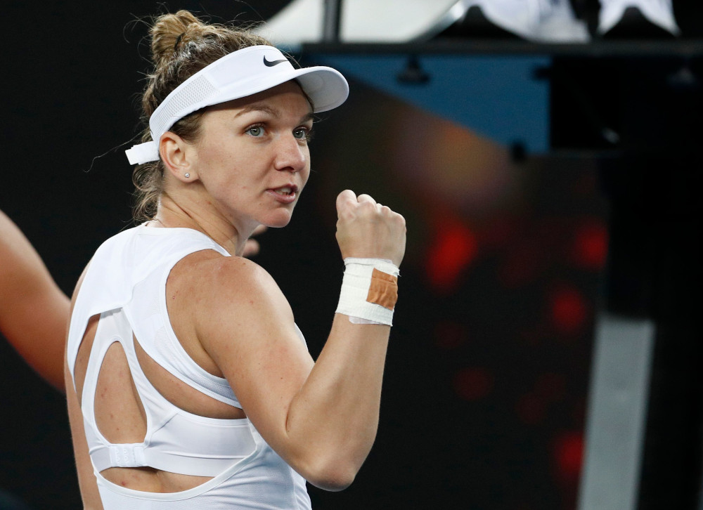 Romania's Simona Halep reacts during the Australian Open first round match against Jennifer Brady of the US at Melbourne Park, Melbourne January 21, 2020. — Reuters pic