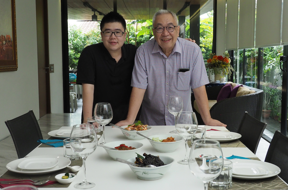 David Leong (left) and his father Raymond Leong run The Ampang Kitchen, a home-based private dining business. — TODAY pic