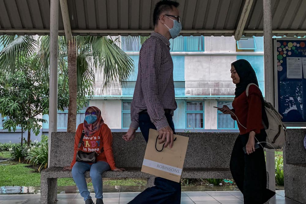 People wearing face masks are seen outside Sungai Buloh Hospital January 29, 2020. — Picture by Hari Anggara