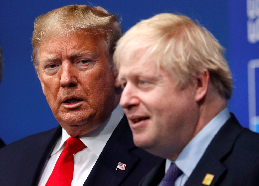 Britain's Prime Minister Boris Johnson welcomes US President Donald Trump at the Nato leaders summit in Watford, Britain December 4, 2019. — Reuters pic